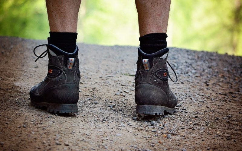 A man wearing hiking boots on the Camino routes