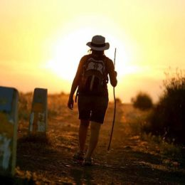 walking alone into the sunset with the arrow on the marker