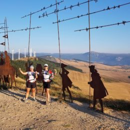 Couple pilgrim posing with famouse landmark
