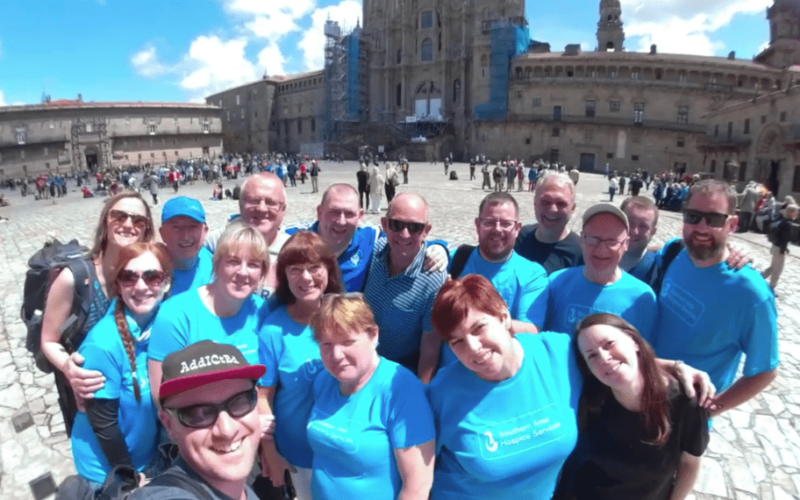 Charity group posing in front of the Cathedral in Santiago