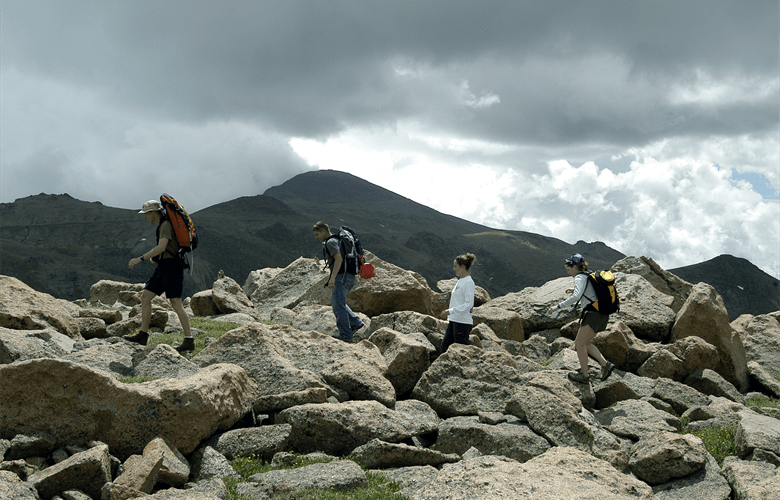 Walkers walking in rocky terrin