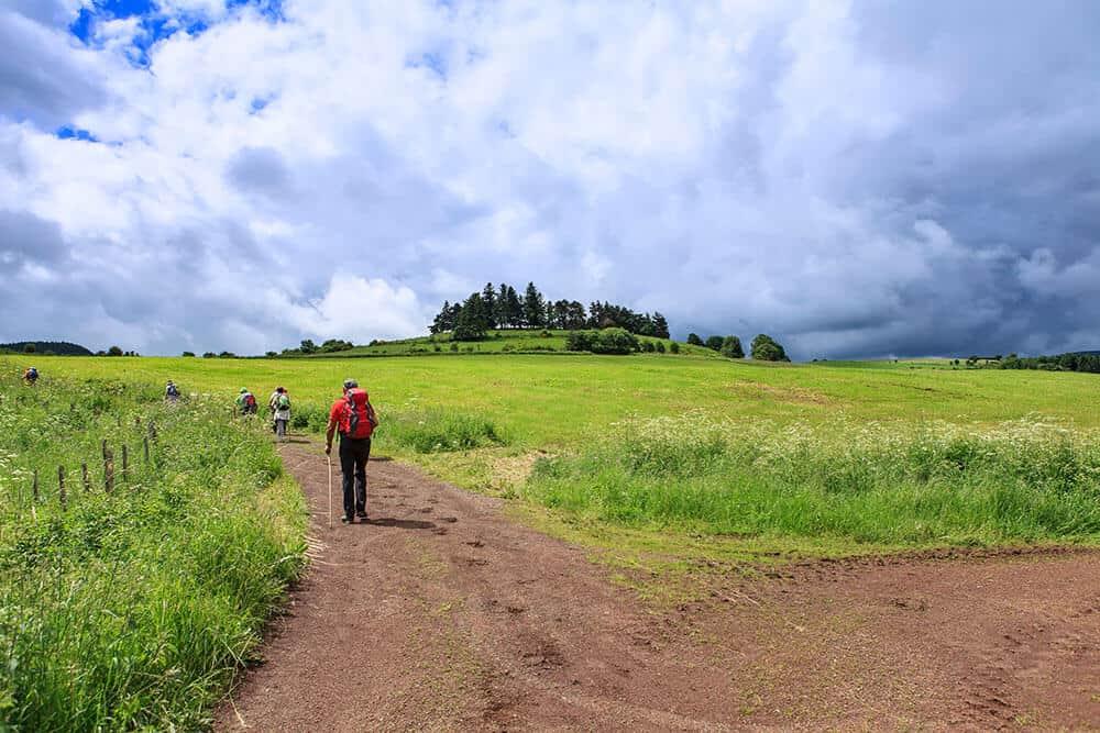 A man walking the Camino de Ingles route
