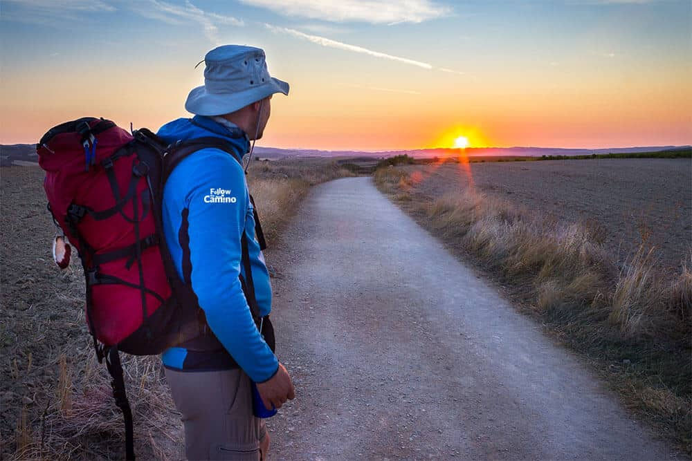 A man looking at the sunset on the camino route in France