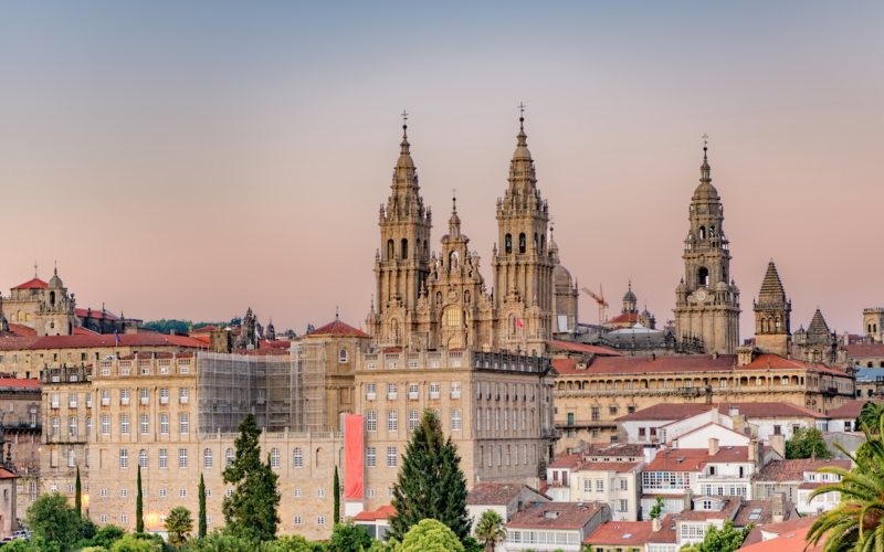 Santiago de Compostela with catedral appearing through the building - sunset