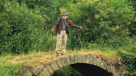 Pilgrim posing on the bridge - Camino