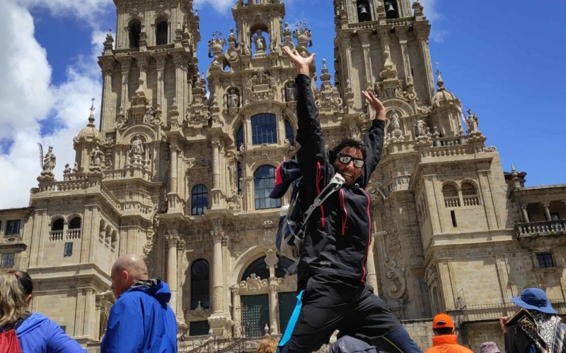 After completing the camino - Skip of Joy in front of Santiago de Compostela cathedral