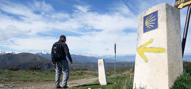 umberto on the camino sign walking pilgrim