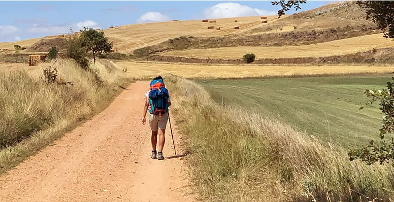 walking french way with backpack