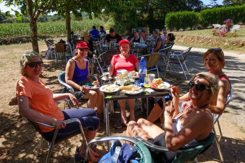 group of pilgrims taking a break for lunch at a cafe on the way of st james